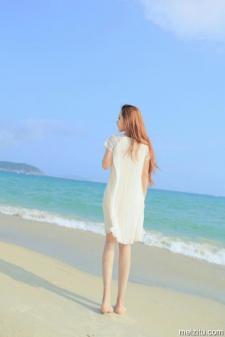 Blue sky, seashore, white dress
