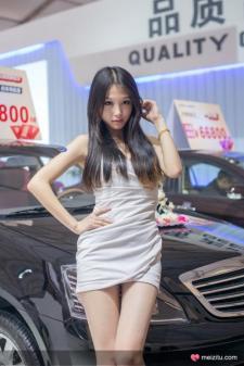 Slim pretty girl in the car show